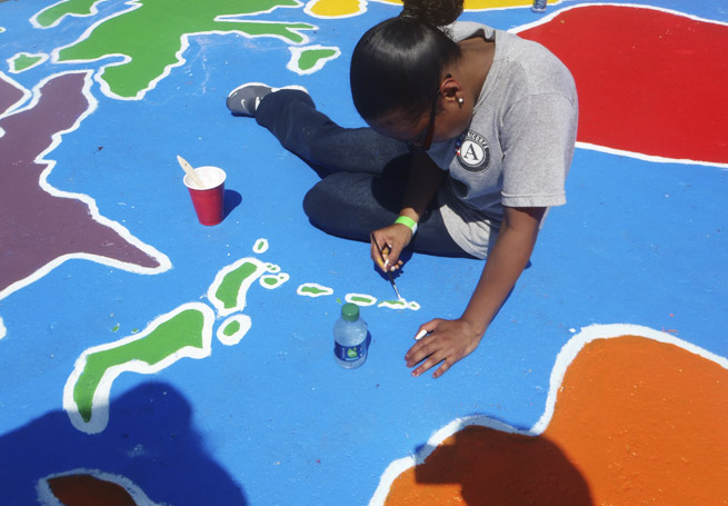 Grants Build it Yourself - girl painting world map