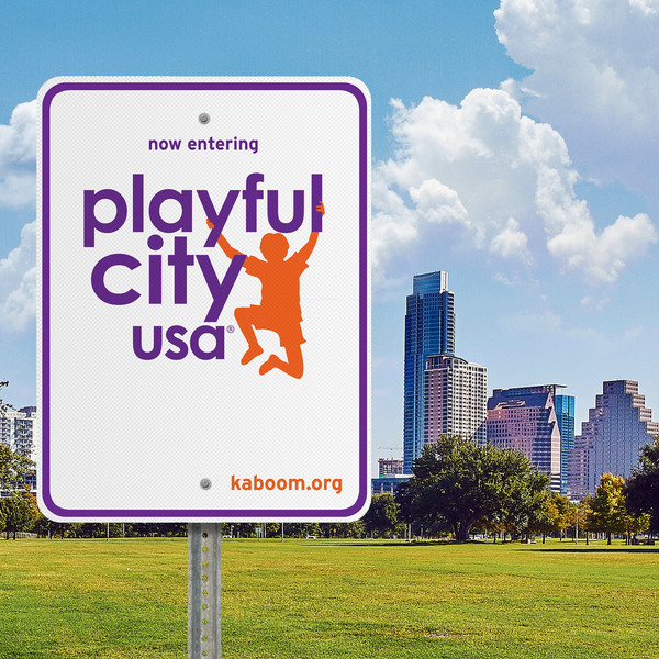 Playful City USA sign in blue clouds