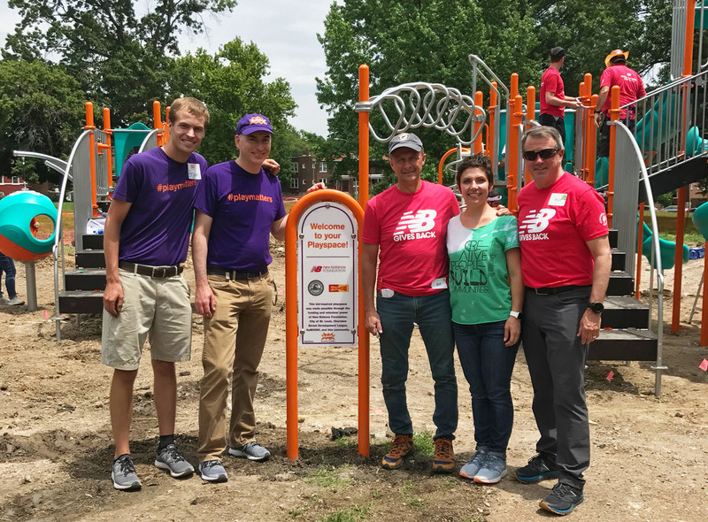 Volunteers celebrate the Gravois Park build day