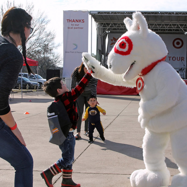 At the Play Everywhere Tour, powered by Target, Bullseye high fives with kids.