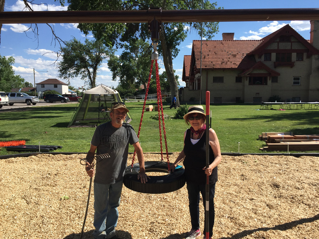 To aduts ppose with a newly constructed tire swing