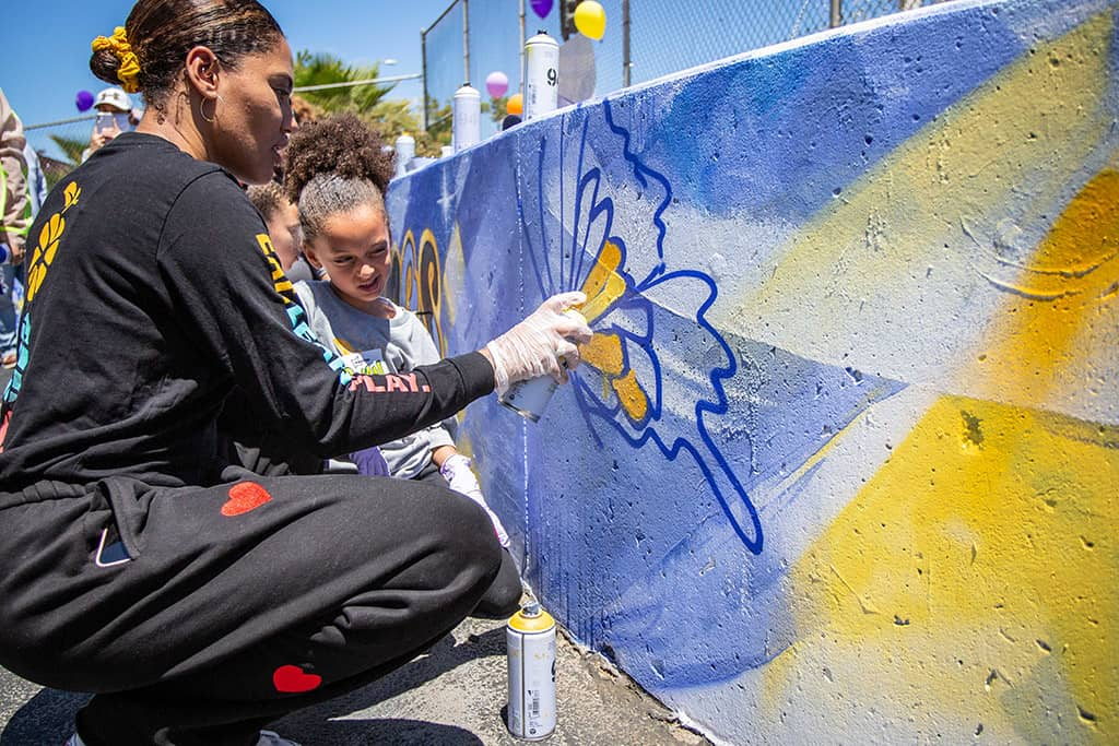 Ayesha and Ryan Curry spray paint butterflies
